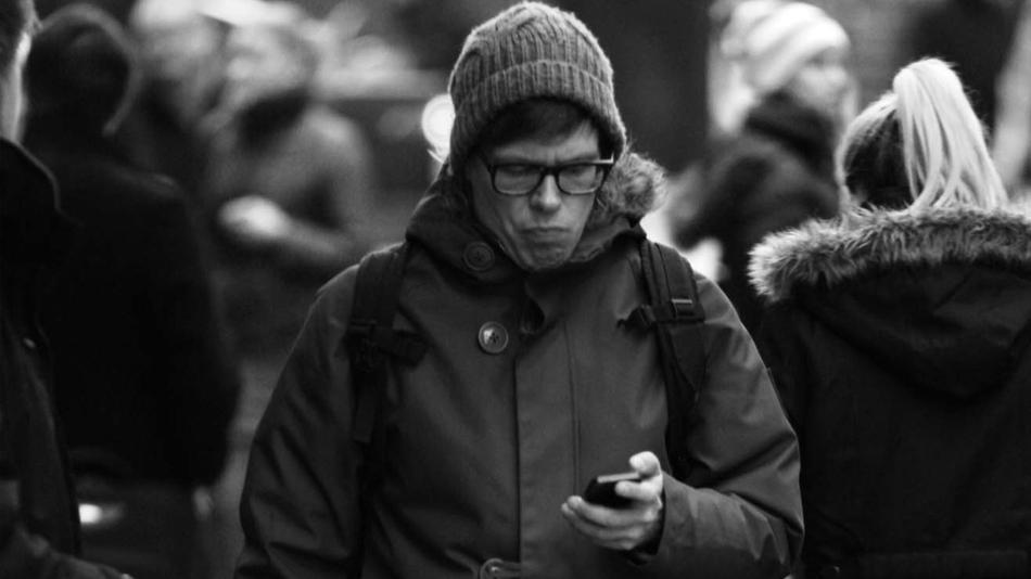 Image result for looking at phone on street